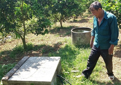 Hai giếng khoan của 2 cha con gia đình ông Kế đều được nhận tiền hỗ trợ. Ảnh: QUỐC CƯỜNG